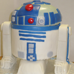 R2-D2 Robot Cake made with rolled fondant. It's truly out of this world!