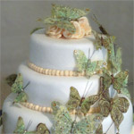 Stacked rolled fondant wedding cake with butterfly cascade