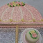 A Parasol Wedding Shower caked with little side cake.