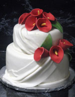 Gum paste Red Calla Lilies on rolled fondant wedding cake